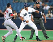 Jose getting picked off first base on 6/2/98 (CP Photo)