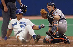 Jose is tagged out at home on 6/12/98 (CP)