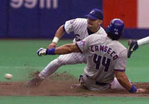Jose getting caught stealing 2nd on 6/25/98 (CP)