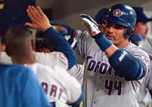 Jose after hitting his 31st homer of the year, on 8/1/98 (AP)