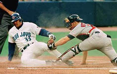 Jose sliding safely into home on 9/4/98 (CP)