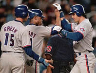 Jose being congratulated after his 42nd homer of the year on 9/10/98 (AP)