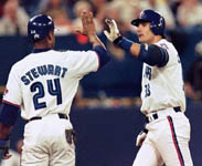 Shannon Stewart high fiving Jose after homer #45 (CP)