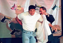 Jose Canseco putting on his new Devil Rays uniform (St. Petersburg Times)