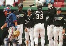 Jose after his 2nd homer of the day - a Grand Slam on 3/15/99 (Toronto Star)