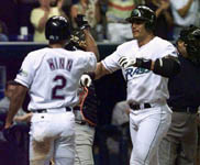 Randy Winn congratulates Jose after homer #8 on 4/21/99 (AP)