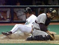 Jose sliding safely into home on 4/23/99 (AP)