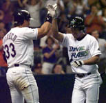 Jose high-fives Randy Winn after his homer on 4/23/99 (AP)