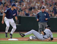 Jose sliding safely into third base on 5/15/99 (AP)