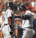 Jose steps on home plate after homer #15 on 5/18/99 (AP)