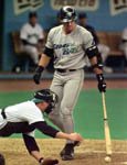 Jose watches catcher Dan Wilson reach for a ball that got away on 5/28/99 (AP)