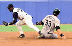 Jose is forced out at second in the first inning on 6/14/99 (AP)